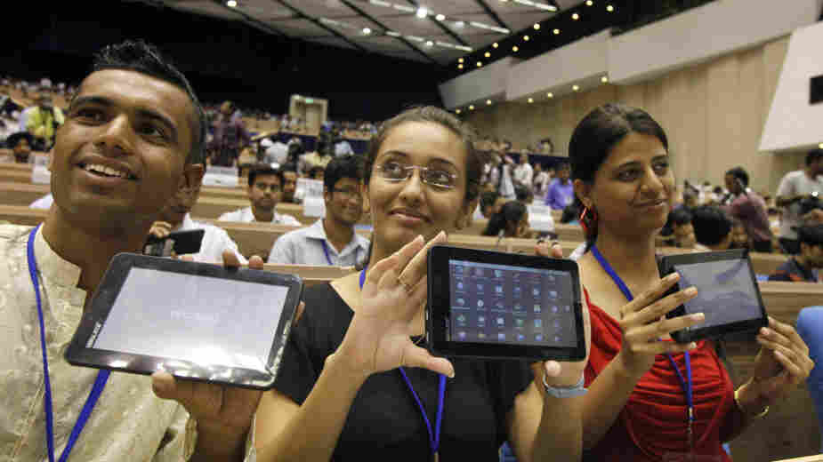 Indian students pose with the supercheap Aakash tablet computers, which they received during the Oct. 5 product launch in New Delhi. The Indian government intends to deliver 10 million tablets to college students across India at a subsidized price of $35.