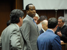 Dr. Conrad Murray, surrounded by his defense attorneys, looks on after the defense rested its case in his involuntary manslaughter trial.