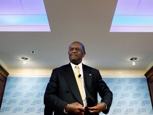 Republican presidential candidate and former Godfather's Pizza chief executive Herman Cain participates in a discussion about his 9-9-9 tax plan at the American Enterprise Institute Oct. 31, 2011 in Washington, DC.