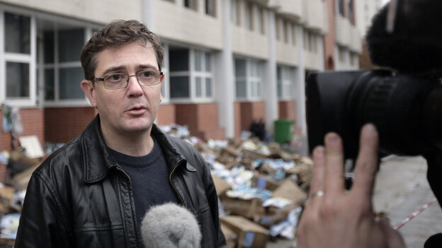 Charlie Hebdo's publisher, known only as Charb, talked to journalists today (Nov. 2, 2011) in front of his publication's burned-out offices.