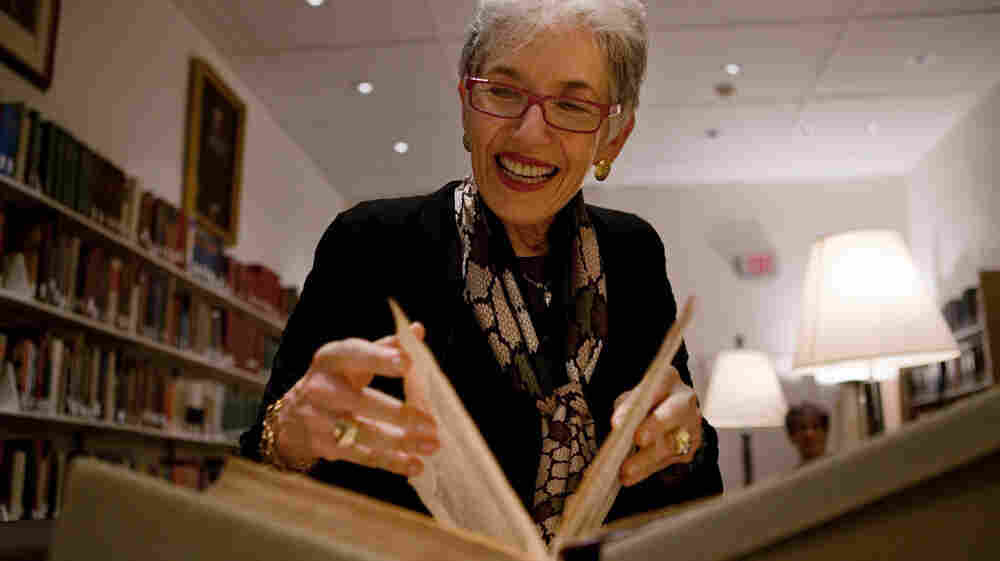 Dava Sobel, who has written a new book about Copernicus, pages through a first edition copy of the astronomer's 1543 work On the Revolutions of the Heavenly Spheres at Dibner Library of the History of Science and Technology at the Smithsonian National Museum of American History in Washington, D.C.