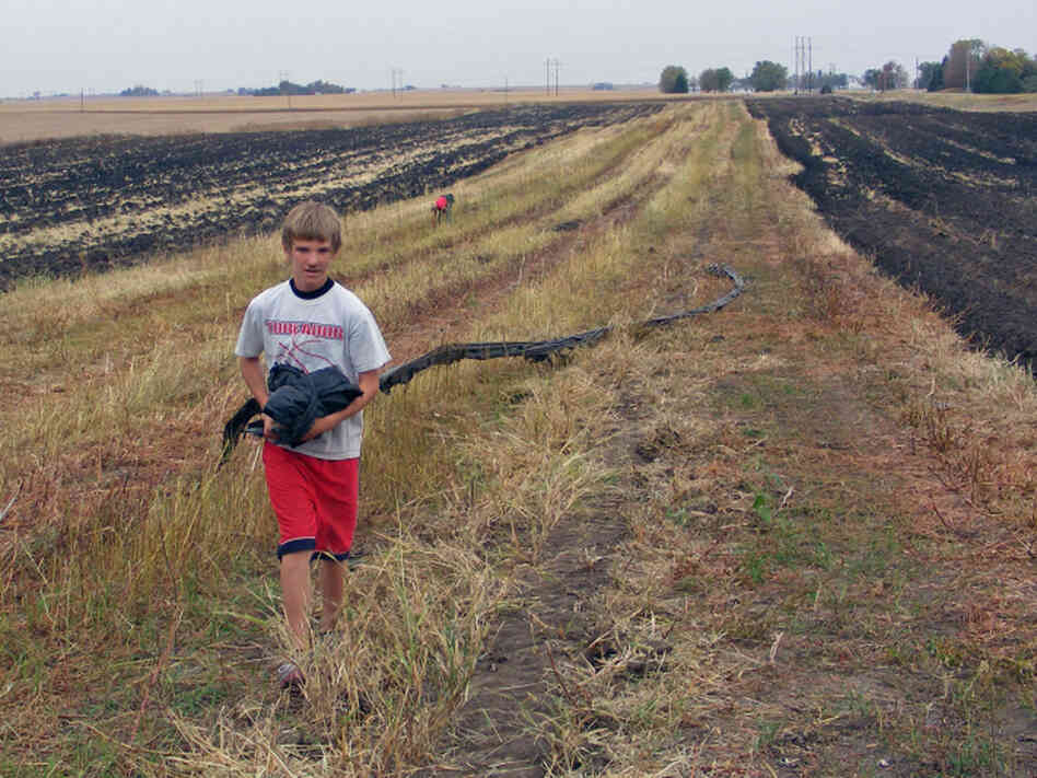 Drew Wilber, 14, works on his parents' 20-acre farm near Boone, Iowa, during his day off from school on Columbus Day.