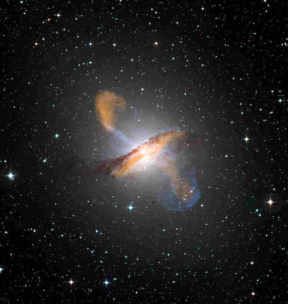 A color composite image of Centaurus A, revealing the lobes and jets emanating from the galaxy's central black hole.