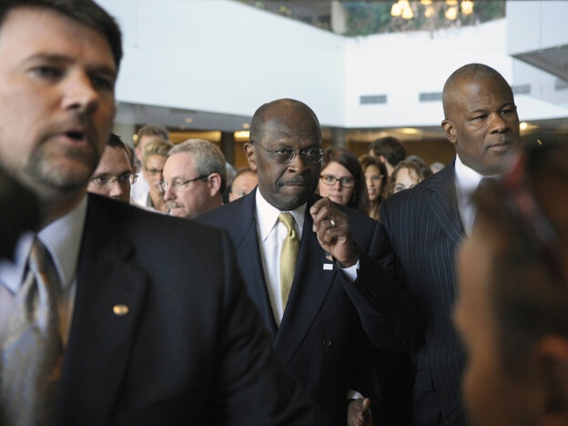Herman Cain heads to speaking engagement at an Alexandria, Va., hotel, Wednesday, Nov. 2, 2011.