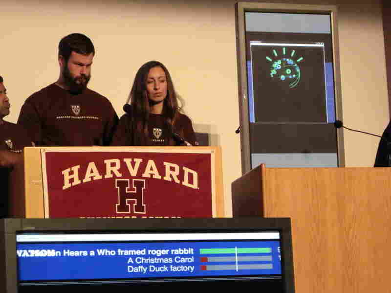 Harvard Business School's Jayanth Iyengar (far left), Jonas Peter Akins and Genevieve Sheenan held their own, but eventually lost to IBM's Watson in a game of Jeopardy at a conference on jobs and technology.