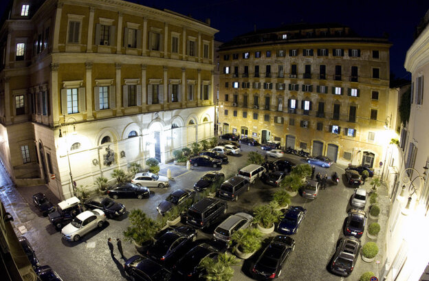 "Official cars and drivers are seen in front of Italian Premier Silvio Berlusconi's residence, left, during a ""Popolo della Liberta'"", People of Freedom, coalition meeting, in Rome."