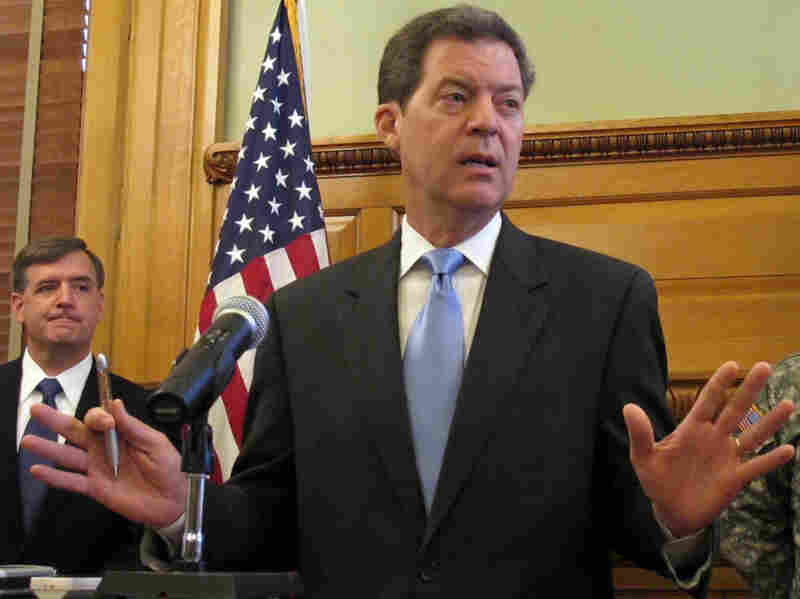"Kansas Gov. Sam Brownback answers questions in July about his policy regarding the new federal health care law. During his campaign for the governor's office last year, he said: ""What we'll do in Kansas is we'll do what we're required to do, but we're gonna fight it all the way."""