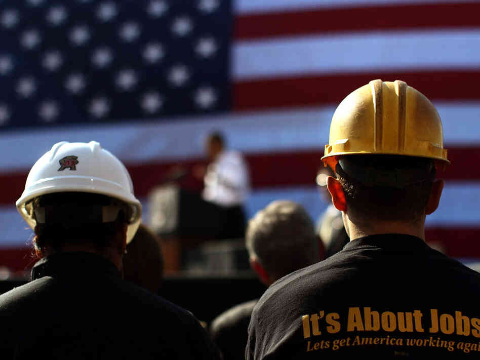Construction workers listen as President Obama speaks at the Georgetown Waterfront Park in Washington on Wednesday.