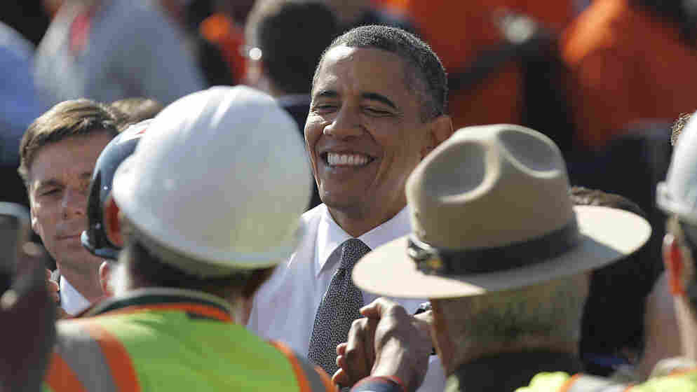 President Obama shakes hands with members of the audience Wednesday after speaking in front of the Key Bridge, in the Georgetown neighborhood of Washington, D.C. He urged Congress to pass the infrastructure piece of the American Jobs Act.