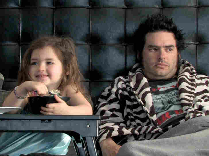 """The film offers glimpses into the lives of punk idols from skateboarder Tony Hawk to """"Fat Mike"""" — Michael John Burkett of the band NOFX, shown with his daughter, Darla."""