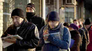 People line up outside an unemployment office in Madrid in February. The country has the eurozone's highest unemployment rate at more than 21 percent.