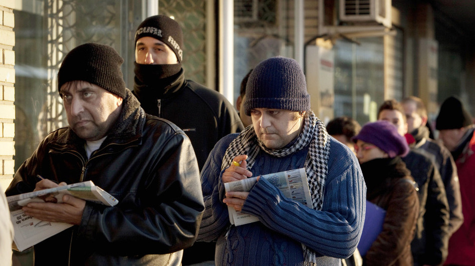 People line up outside an unemployment office in Madrid in February. The country has the eurozone's highest unemployment rate at more than 21 percent. (AP)
