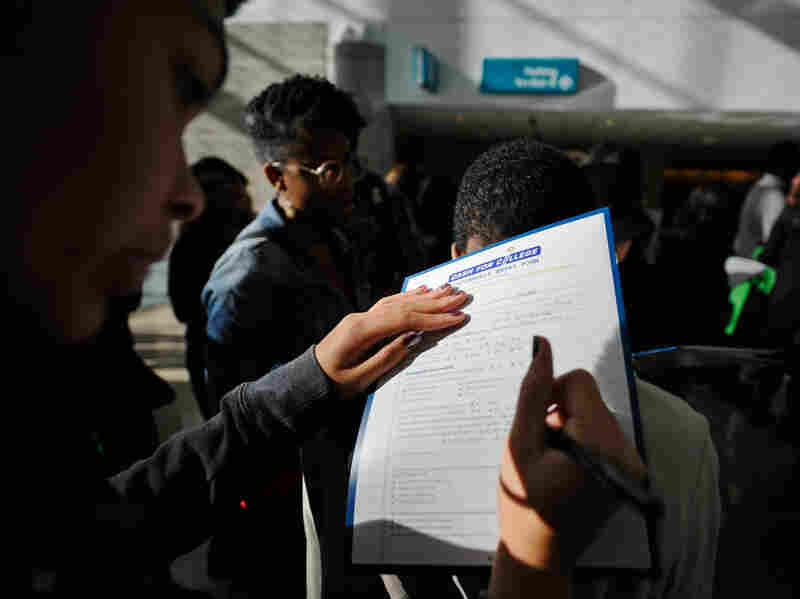 College students who graduated in 2010 carried 5 percent more debt than in the previous year, according to new data. In this photo from last December, a student fills out an application for a chance to win a scholarship worth $30,000, at a Cash for College event organized by the California Student Aid Commission.