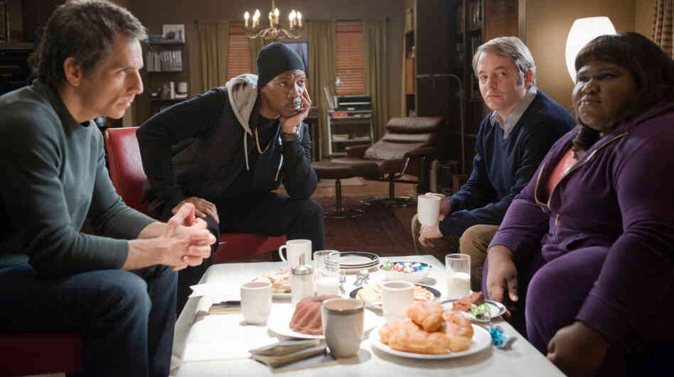 When A Plan Comes Together: Eddie Murphy (second from left) is a small-time hoodlum recruited by a gang of would-be thieves (Ben Stiller, left, Matthew Broderick, and Gabourey Sidibe) who aim to steal back their life savings from a Wall Street swindler.