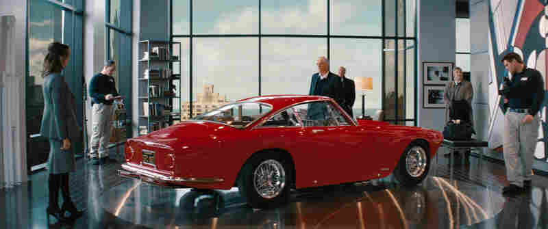Seeing Red: Alan Alda (center, with Tea Leoni) and the Ferrari he keeps in his luxury-high-rise living room are the targets of both the payback plot and an FBI investigation.