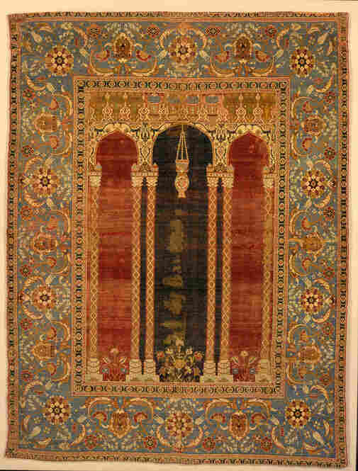 A prayer rug from 16th-century Istanbul features an architectural design.