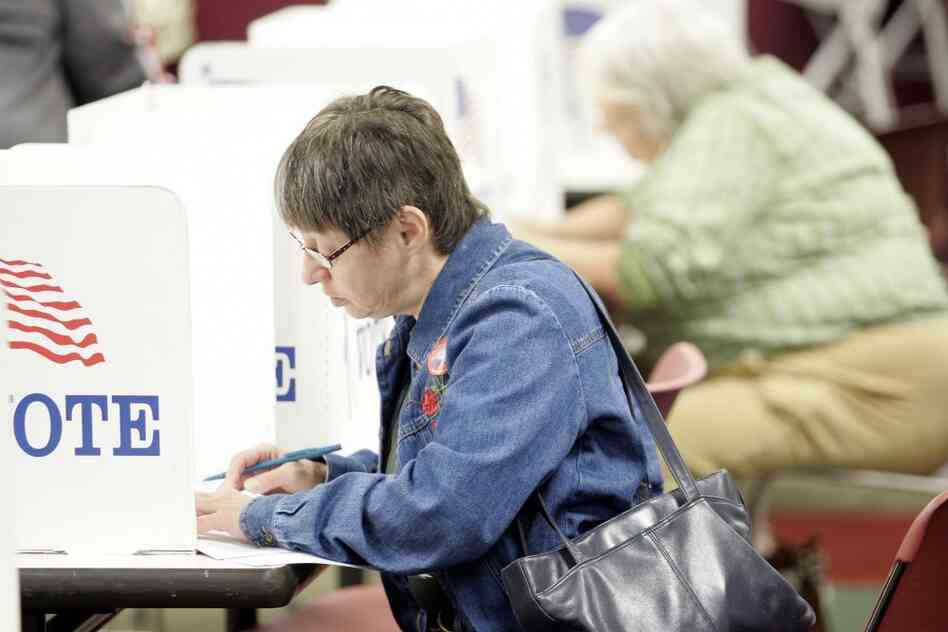 A woman casts her ballot during early voting in Toledo, Ohio. Members of the silent generation are more likely to vote for Republicans than for Democrats, according to a recent study by the Pew Research Center.