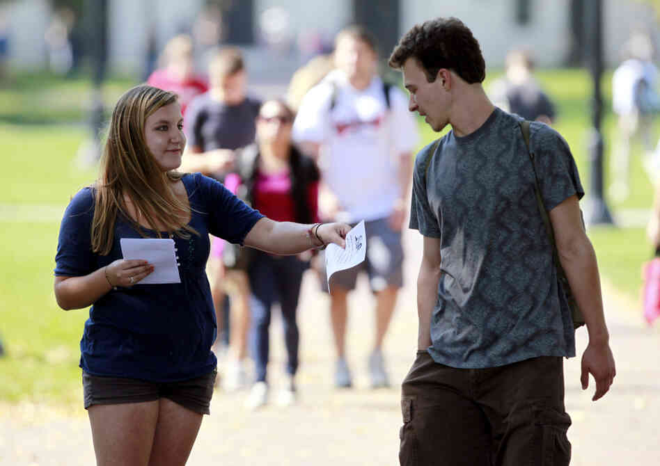 Genna Schwartz (left) of the Ohio State University Student Democrats tried to hand out information about President Obama's Oct.