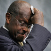 Republican presidential hopeful Herman Cain wipes his brow during a discussion on health care Wednesday in Washington. The former head of the National Restaurant Association has been under fire in recent days over sexual harassment allegations and his response to them.