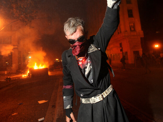 Occupy Oakland protester Mike Clift ran from teargas early today (Nov. 3, 2011).