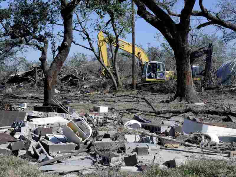 A track hoe sifts through Hurricane Ike debris in Smith Point, Texas, in 2008. In 2009, HNTB won a contract to manage disaster recovery, including the aftermath of Hurricane Ike.