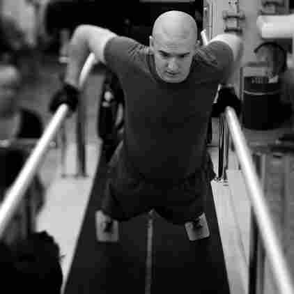 Lance Cpl. Jake Romo does physical therapy at the Naval Medical Center in San Diego, Calif. He lost both legs in an explosion in Sangin, Afghanistan, in February 2011, while serving with the 3/5 Marines.