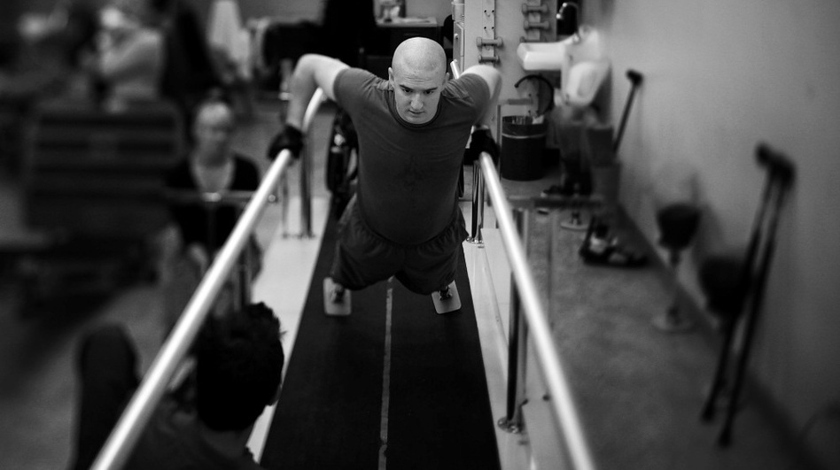 Lance Cpl. Jake Romo does physical therapy at the Naval Medical Center in San Diego, Calif. He lost both legs in an explosion in Sangin, Afghanistan, in February 2011, while serving with the 3/5 Marines. (NPR)