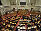 Greek deputies debate during a confidence vote at the Greek Parliament in Athens.