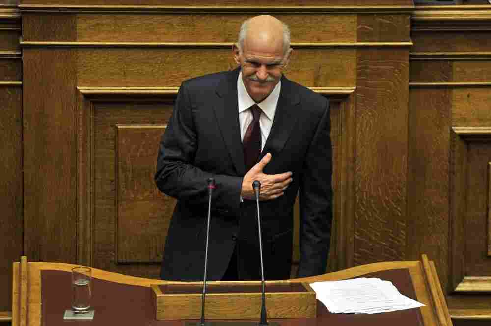 Greek Prime Minister George Papandreou greets members of parliament at the end of his speech during a debate on the confidence vote at the Greek Parliament in Athens.