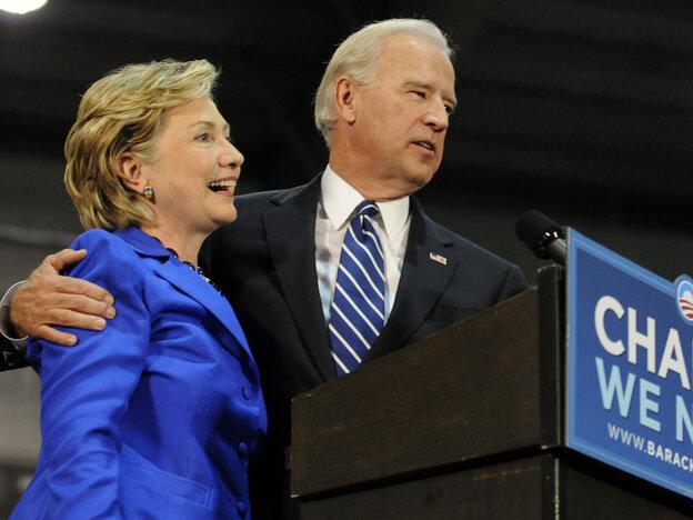 Democratic vice presidential candidate U.S. Senator Joe Biden (D-DE) (R) and U.S. Sen. Hillary Clinton (D-NY) (L) speak at a rally in support of then Democratic presidential nomineee U.S. Sen. Barack Obama (D-IL) on Oct. 11, 2008 in Scranton, Pennsylvania.