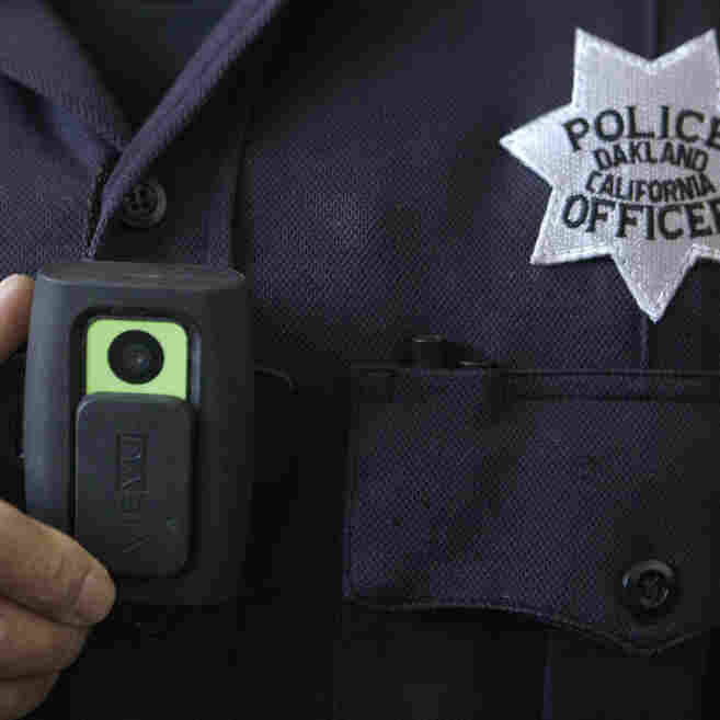 Officer Huy Nguyen shows a video camera worn by some officers in Oakland, Calif. Oakland and dozens of other police departments across the country are equipping officers with tiny body cameras to record anything from a traffic stop to a violent crime in progress.