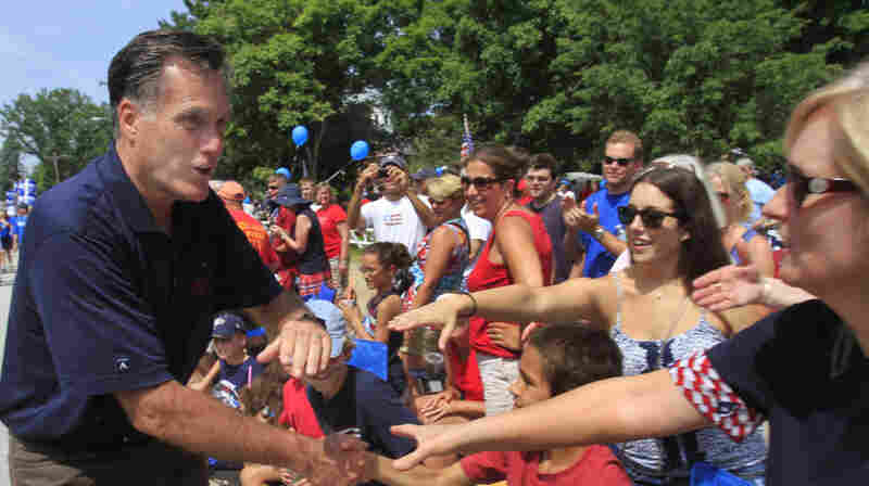 Republican presidential candidate and former Massachusetts Gov. Mitt Romney works the crowd as he marches in the Fourth of July parade in Amherst, N.H. Members of Generation X supported GOP candidates by a small margin in 2010. Now they are split between Romney and President Obama.