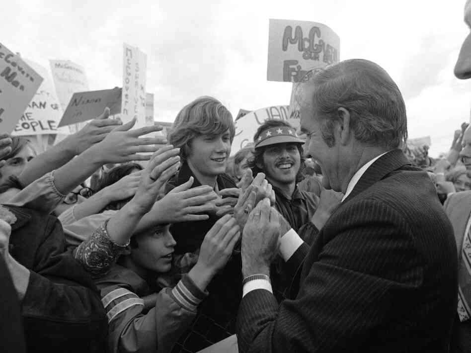 Democratic presidential candidate George McGovern greets young admirers in his home state at an airport rally in Sioux Falls, S.D., in 1972. Many baby boomers voted for McGovern in their first election, agai