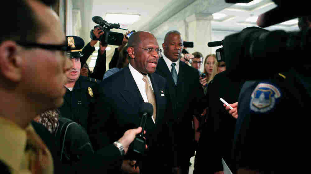 Tuesday: Republican presidential candidate Herman Cain is surrounded by police, body guards, staff members and journalists on Capitol Hill.