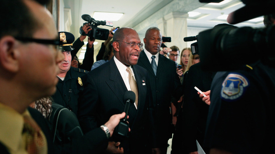 Tuesday: Republican presidential candidate Herman Cain is surrounded by police, body guards, staff members and journalists on Capitol Hill. (Chip Somodevilla/Getty Images)