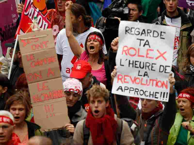 Demonstrators chant and shout as they protest against tax havens and the G20 Summit, on France's border with Monaco on Nov. 3, 2011 in the village of Cap D'Ail, France.