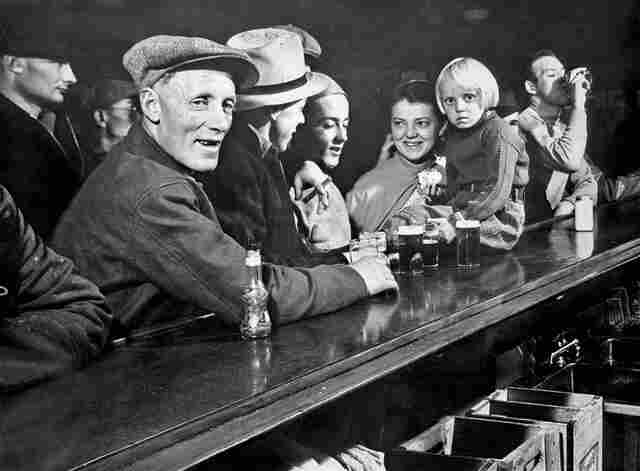 One of the photos from Margaret Bourke-White's cover story in the first issue of Life: Residents of a Fort Peck gather at a saloon.