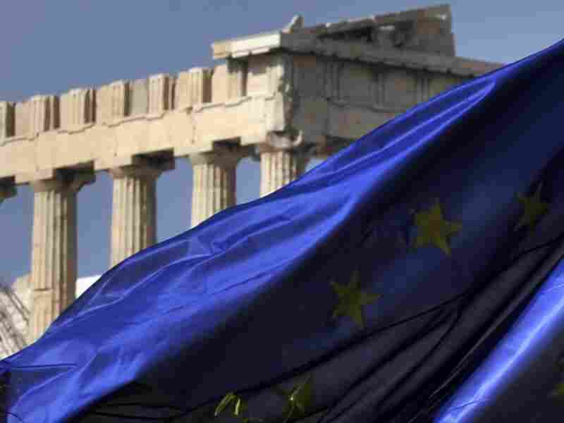 Columns of the Parthenon temple are seen behind an EU flag in Athens on Nov. 4, 2011.