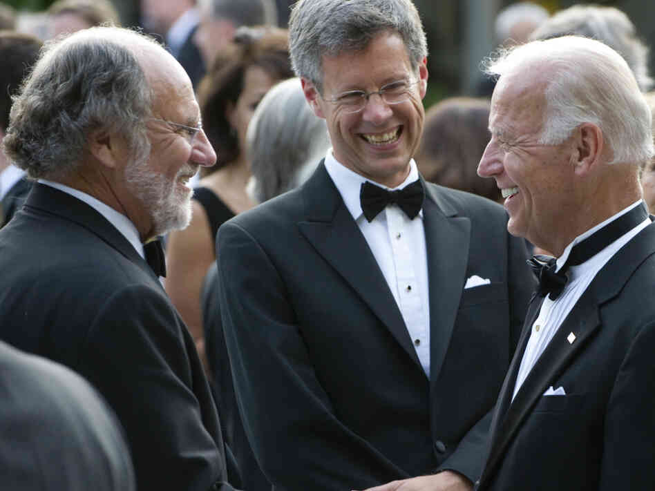 Former U.S. Senate colleagues, Vice President Biden and Jon Corzine (left) greet each other at a White House reception, June 7, 2011.