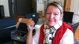 Heidi Traverso, director of business development at Vievu in Seattle, holds the company's pager-sized video camera, designed to be worn on a police officer's uniform. The officer activates the camera by sliding open the protective cover. It can record for up to four hours.