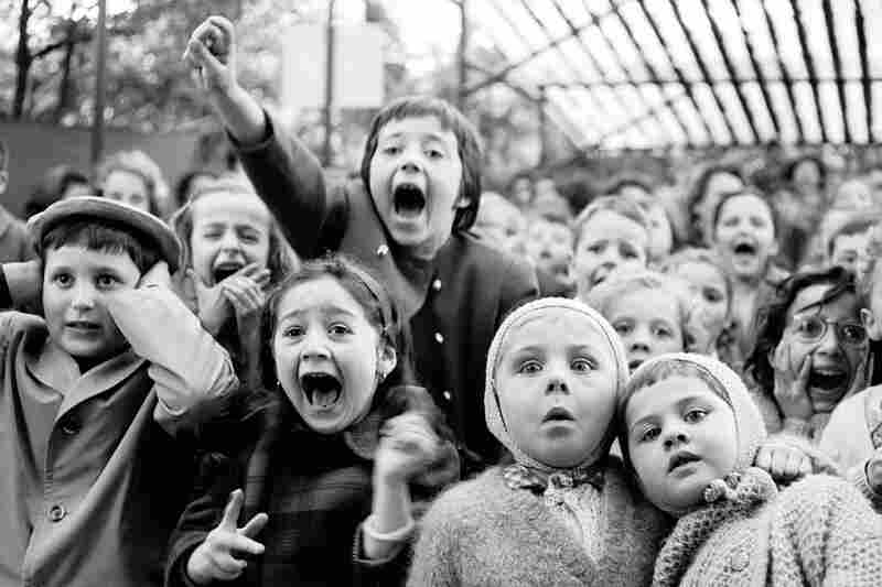 Alfred Eisenstaedt captured timeless moments — like this scene of children at a puppet show in Paris, 1963.