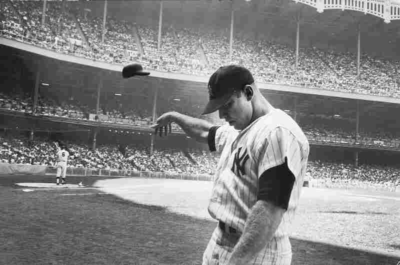 Mickey Mantle tosses a cap during a game at Yankee Stadium in 1965.