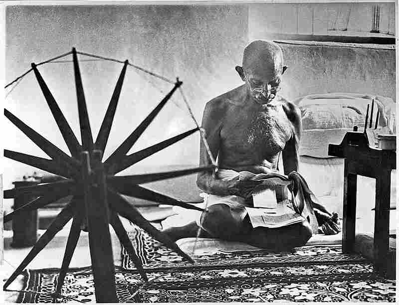 Gandhi sits near his spinning wheel during a boycott of British textiles in 1946.