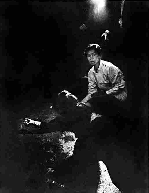Busboy Juan Romero cradles Robert F. Kennedy's head after he was assassinated in 1968.