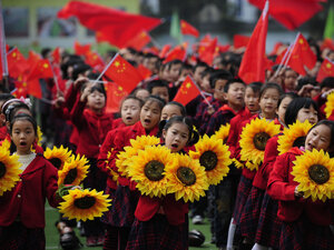 Chinese children celebrate the Communist Party in Chongqing municipality in March. Bo Xilai, the region's party secretary who is vying for a place in the Politburo Standing Committee, espouses a government-intervention model to e