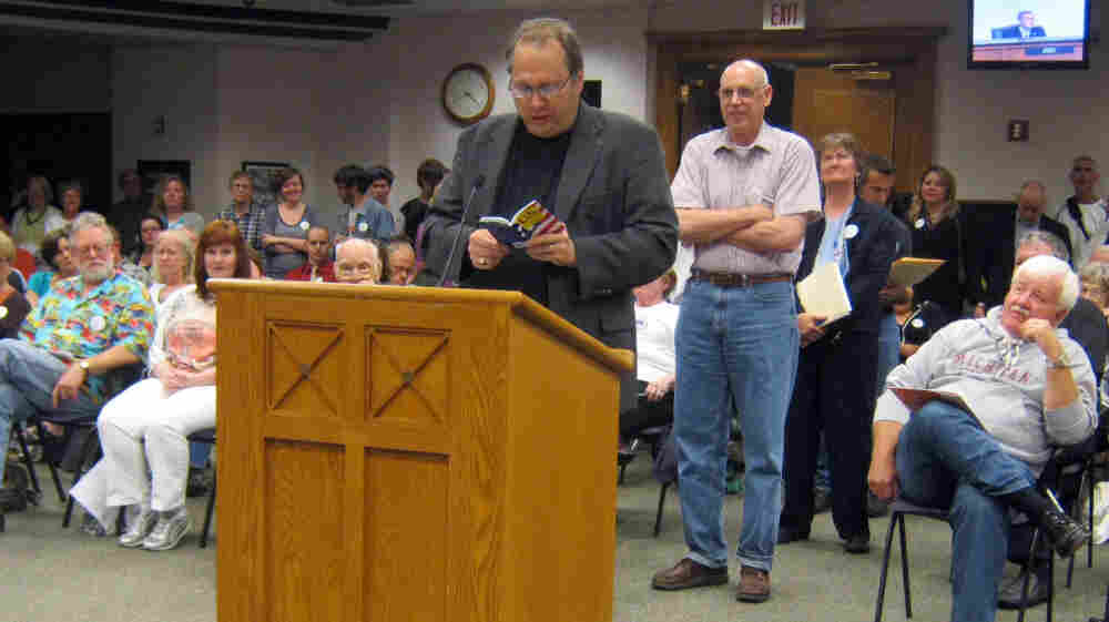 The Rev. Bill Freeman reads from a copy of the U.S. Constitution during a public hearing before the Holland City Council in June. Despite appeals from Freeman and others, the council decided not to expand its anti-discrimination laws to include gay, bisexual and transgender people.