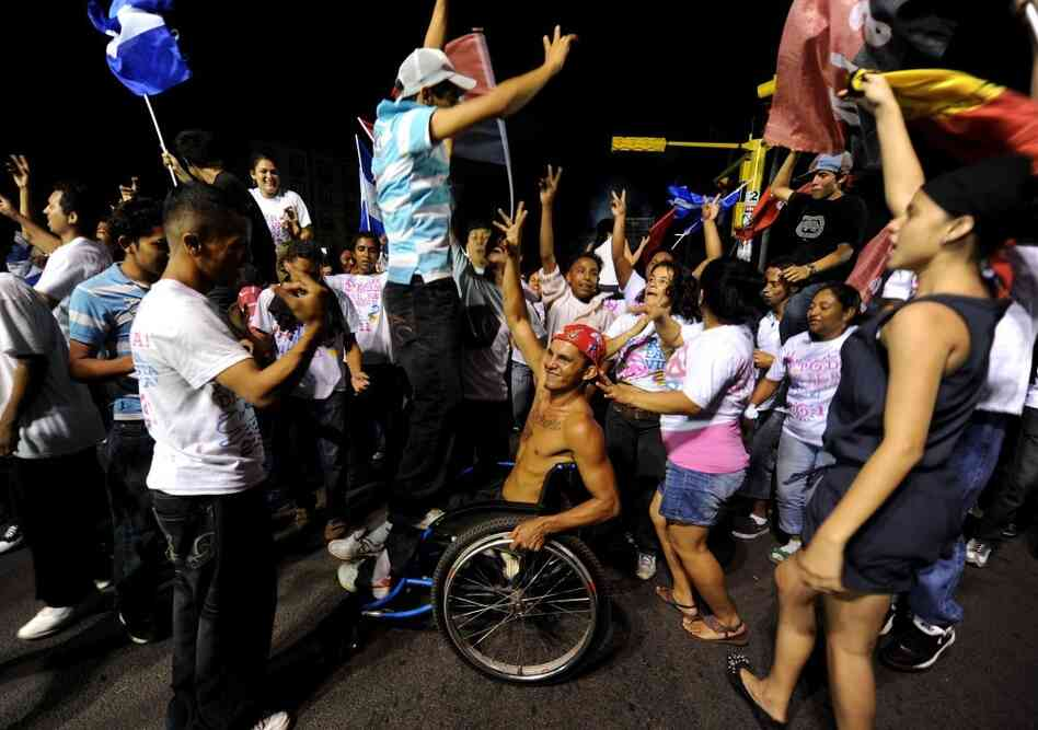 Supporters of Nicaraguan President and presidential candidate Daniel Ortega celebrate following the presidential election in Managua on Nov. 6.