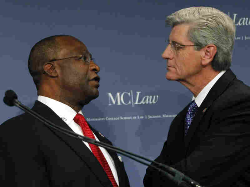 Republican Phil Bryant (right) and Democrat Johnny DuPree confer prior to their gubernatorial debate at the Mississippi College School of Law auditorium in Jackson, Miss., on Oct. 14.