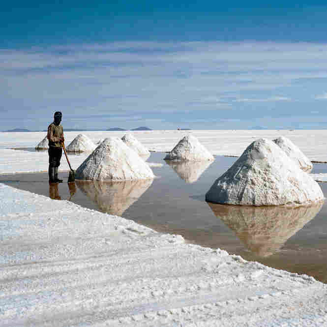 A salt worker pauses in the Salar de Uyuni, the world's largest salt flat, in Bolivia.