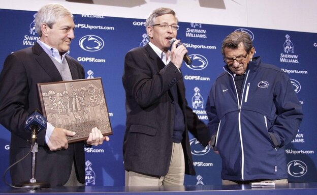 Penn State Athletic Director Tim Curley (center), pictured with head football coach Joe Paterno (right) and university President Graham Spanier, is expected to turn himself in Monday in Harrisburg, Pa.